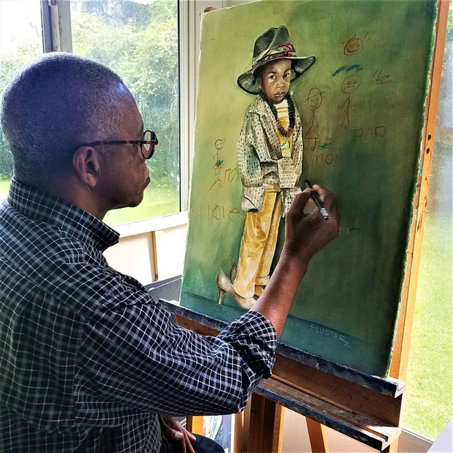 Eluster Richardson works on a painting in his studio